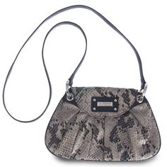 """Stella Hip Bag The Stella Hip Bag features ultra-soft taupe and black snakeskin print faux leather that glistens with shimmers of silver. Bag is completely self-contained—it is not interchangeable like our traditional bags. Long handle (included) allows for both cross-body and over-the-shoulder toting. And it's just the right size for when you're cruising """"light."""" Black faux leather and rivet accents; easy snap-closure. Dimensions: 6"""" tall x 9 ½""""wide; handle is ½"""" wide with a 21"""" drop..."""