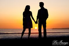 Silhouette holding hands during sunset...can't wait for the beautiful pics we can take in Hawaii!!:)