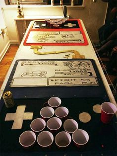 Because Pokemon and beer pong are both serious business, here's a homemade table combining the two. You can only play beer pong on it though, the Game Boys don't actually play Pokemon. Gameboy Pokemon, Cool Pokemon, Play Pokemon, Pokemon Birthday, Pokemon Party, Pokemon Table, Pokemon Halloween, 90th Birthday Parties, 25th Birthday