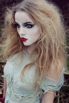 Porcelain doll halloween makeup. Love the eyelashes.. they look like butterflies | Need more Halloween inspiration? Find it here --> http://www.pinterest.com/thevioletvixen/halloween-makeup-insanity/