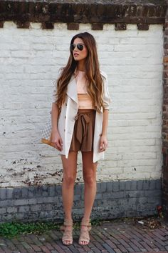 Spring Transitioning — Negin Mirsalehi. Zara crop top in a blush metallic shade. Classic Trenchcoat. Flowy Shorts. River Island Sandals Old Collection. Louis Vuitton Noe Bag Rings
