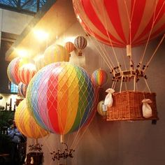 hot air baloon-looks like beach balls, netting and little baskets