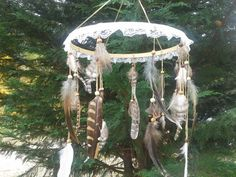 Handcrafted Bohemian Native american style feather mobile. Perfect hanging above a crib, or used as a unique decoration anywhere in your house!