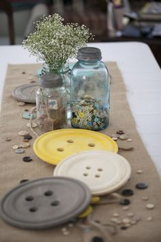 Chinet buttons, mason jar full of buttons, mason jar with baby's breath, bulap table runner