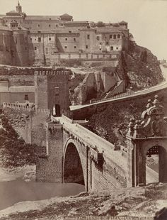 ca. 1870-1880, Toledo, Spain --- The Alcazar fortress and the Alcantara Bridge over the Tagus River in Toledo, Spain. --- Image by © Alinari Archives/CORBIS