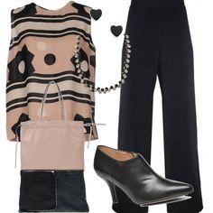Outfit che guarda all'estate, con la casacca in seta di Marni, ma che si proietta verso l'autunno, con i tronchetti con il tacco e gli ampi pantaloni. La borsa è in pelle bicolore molto ampia, completano il tutto gli accessori, collana e orecchini a cuore.