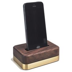 Rich walnut and solid brass iPhone dock by Grovemade.