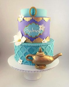 Multi-tier cake in teal and purple with Jeanie's lamp and flowers. Jasmine Birthday Cake, Aladdin Birthday Party, Aladdin Party, Cake Birthday, 5th Birthday, Princess Jasmine Cake, Shimmer And Shine Cake, Arabian Party, Arabian Nights Party