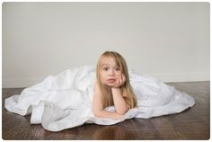 So cute, I love the little girl in her mom's wedding dress photos! laurieendsley.com, laurie endsley photography photography, photography ideas, posing, children, family, child photography, session ideas, stylized session