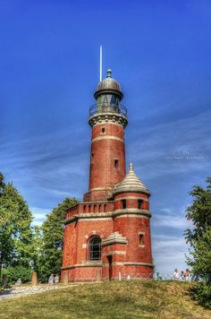 Leuchtturm Holtenau (lighthouse) on the north shore of the entrance to Nord-Ostsee-Kanal (Kiel Canal), Germany, looks…