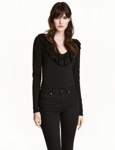 Check this out! Long-sleeved, fine-knit sweater in a viscose blend with a sheen. Low-cut V-neck with ruffle at neckline. - Visit hm.com to see more.