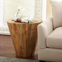 Timber Side Table   Crafted of smooth wood planks with visible knots and rings, this conical end table has a rough-hewn appeal.