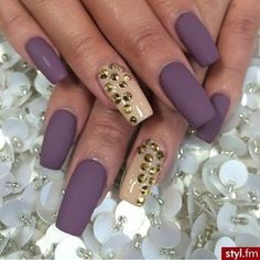 Pretty matte purple with nude and stone accent nails