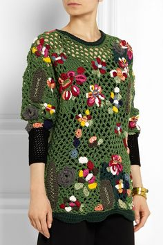 Okay, how the heck did I miss this over-the-top crocheted sweater from the Valentino Resort 2015 collection? If you've got north of $7 grand to drop on a sweater, it's yours (that's the sale price, btw) -- or you could just hook yourself a mesh-knit sweater and embellish it with some flower motifs.