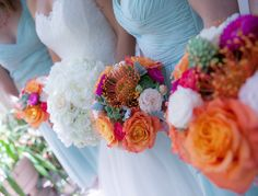 Wedding Flowers: Elegant all-white hand tied bridal bouquet with roses and hydrangeas. Bridesmaid bouquets made with orange-red roses, protea, and green succulents.