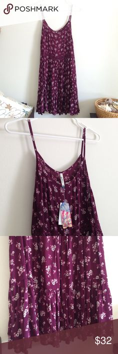 """SUNDAY SALE Wine Floral Sundress Brand new with tag. Beautiful colors floral sundress. Lightweight. Crochet at waist around. 100% rayon. Measurement laying flat: bust: 20"""" length: 33"""" (30) Reasonable offers always welcomed! •• Wall Flower Dresses Midi"""