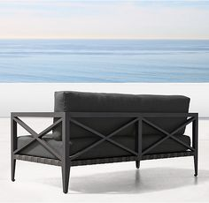 "RH's 62"" Mustique Sofa:Designed in Australia by a family-owned company known for its meticulous metalwork, our collection pairs classical elements with the low-profile cubes of mid-century modernism. Masterfully handcrafted of rustproof metals and mesh strapping detailed with brass studs, it's a choice for the ages."