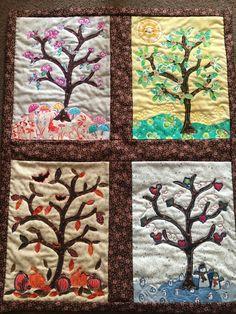 Four seasons appliqué quilt