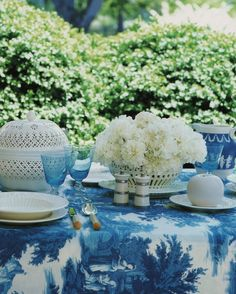 I love the creamware with the blue & white tablecloth...I have the large bowl/pot with cover at left...   :)