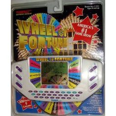 Wheel of Fortune Handheld Game 1990s toys. Probably still have it somewhere at my parents house.