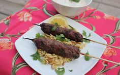 Beef Keftas are Middle Eastern inspired meatballs on a stick and delicious when grilled and stuffed into a greek pita.
