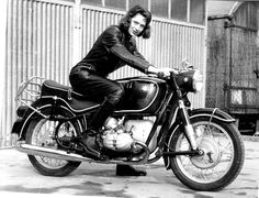 There's nothing quite like a lady decked out in a leather riding suit sitting atop a classic motorcycle.
