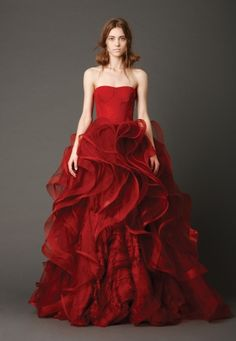 From Vera Wang Spring 2013 Bridal Collection-- all red.  I'm obsessed with everything about this dress, particularly the color. It almost makes me want to pull a Liz Lemon.