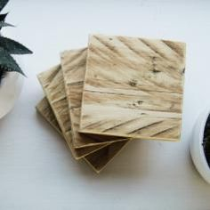 Handmade coasters made from recycled pallets. They have been sanded smooth and varnished to create a warm wood effect that looks great in any home.