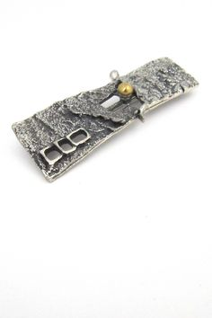 Guy Vidal, Canada - pewter and bronze 'windows' brooch