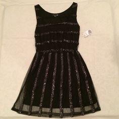 Short length black dress. Short black dress with black sequins. Never been worn! Tags still on. Forever 21 Dresses Midi