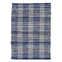 Think of this rug as you would your favorite jeans—it's just that versatile and essential, from living room to office. The plaid is woven from cotton yarns in every shade of blue (with hints of ivory), to achieve the broken-in effect of much-loved denim.