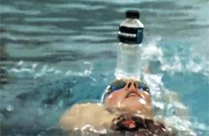 Missy Franklin balancing a water bottle on her head while swimming to practice head stability during her backstroke