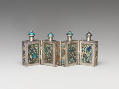 Hinged Snuff Bottles Qing dynasty (1644–1911) | 19th century | China | Silver with painted enamel panels and enamel stoppers | H. 1 11/16 in. (4.3 cm); L. 3 1/2 in. (8.9 cm)