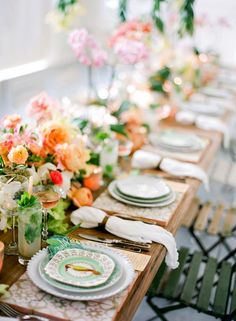 Stunning tablescape for Cuban-themed dinner party// orchids and roses