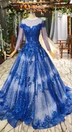 Gorgeous Long Sleeve Sheer Neck Tulle Blue Applique Ball Gown Prom Dresses with Beads Source by simibridalsdresses dresses gowns Puffy Dresses, Cute Prom Dresses, Pretty Dresses, Homecoming Dresses, Ball Gowns Prom, Ball Dresses, Prom Gowns With Sleeves, Debut Gowns, Princess Ball Gowns