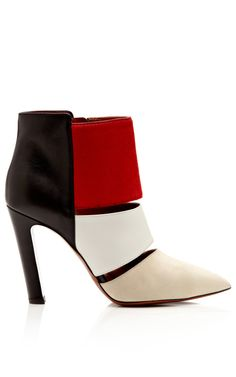 Fashion Month Must Own: Statement bootie. Suede Leather and Pony Hair Nanette Bootie by Calvin Klein Collection Now Available on Moda Operandi