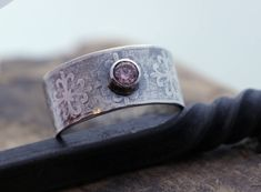 A personal favorite from my Etsy shop https://www.etsy.com/listing/537294358/sterling-silver-gemstone-wide-band