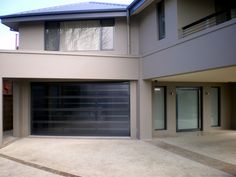Our Ultimate Sectional Garage Doors are all about flaunting absolute street appeal. Create a custom design to suit your taste and budget. Centurion's Ultimate Range doors are each distinctive in their own right. Custom Garage Doors, Garage Door Design, Custom Garages, Garage Game Rooms, Sectional Garage Doors, Laser Cut Panels, Design Your Own, Custom Design