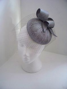 Ide - Silk Pillbox, percher hat, fascinator with bird cage veil. $140.00, via Etsy.