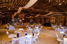 Wide shot of reception hall inside the barn - Wedding Venues In Raleigh