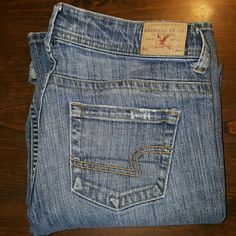 American Eagle Jeans These are American Eagle Jeans.  They are size 10 Regular fit.  Look to be boot maybe a lil flare.  Good condition with some awesome lil factory distressed patches.  Nice jeans for a nice price American Eagle Outfitters Jeans Boot Cut