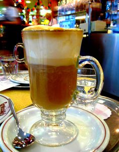 Vienna Coffee (Vienna). 'It is made by preparing two shots of espresso in a standard sized coffee cup and infusing the coffee with whipped cream (as a replacement for milk and sugar) until the cup is full.' http://www.lonelyplanet.com/austria/vienna