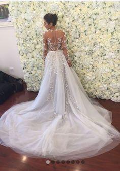 Custom designed Paolo Sebastian wedding gown. Comes with long veil, detachable full skirt and under garment. Please note the undergarment was NOT worn on the day of the wedding. After wearing my wedding dress all day it is in almost immaculate condition and definitely does not look second hand. For any questions please message me.