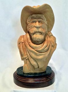""""""" Bull Rider """", carved by Caricature Carvers of America member, Harley Schmitgen."""