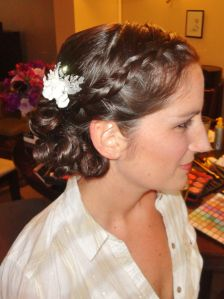 Braided front that goes into curls in the back, with a flower.