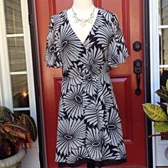 """Silk Trina Turk Dress HP4/22 lwschlprncss Faux wrap black and white graphic print over black silk lining. Hem peeks out the bottom. Sheer butterfly sleeves. Zips in back. Length is 36"""" waist is 30"""" . 100 % silk dress and lining. Trina Turk Dresses"""