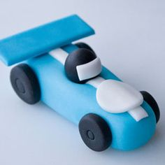 How to make race cars for a birthday cake using gumpaste and fondant.