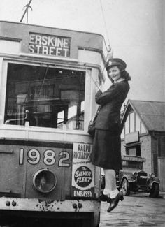 Femal conductor stands on the front of a tram smiling at the camera. Great Photos, Old Photos, Tramway, Light Rail, Oxford Street, Work Inspiration, Sydney Australia, The Good Old Days, Public Transport