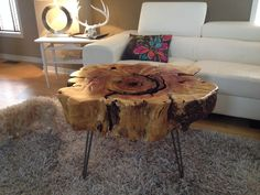 Stump table with hairpin metal legs. Stump End Table -Maple Live edge wood coffee tables www.serenitystumps.com Stump coffee tables like Ellen Show