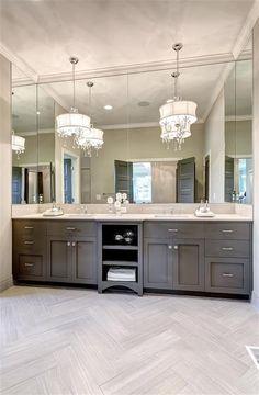 Beautiful bathroom with dark brown double sinks.